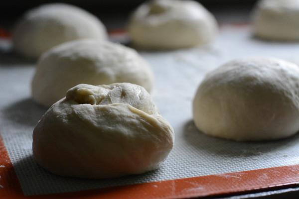 Shaping and rising pretzel rolls