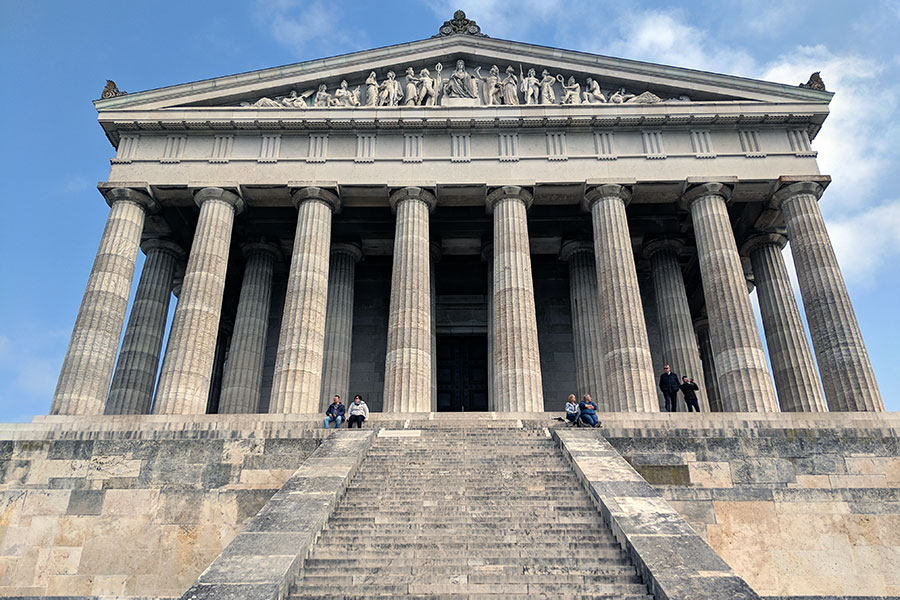 People sit on the steps in front of Walhalla, as it overlooks the Danube in Donaustauf, near Regensburg, Germany.