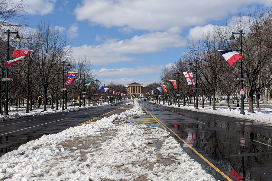 Snow lines the Benjamin Franklin Parkway ahead of the Art Museum in Philadelphia.