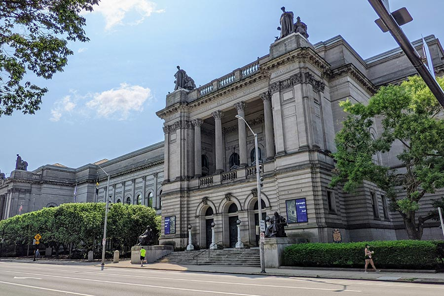 Notable sculptures adorn and surround the Carnegie Music Hall in Pittsburgh.